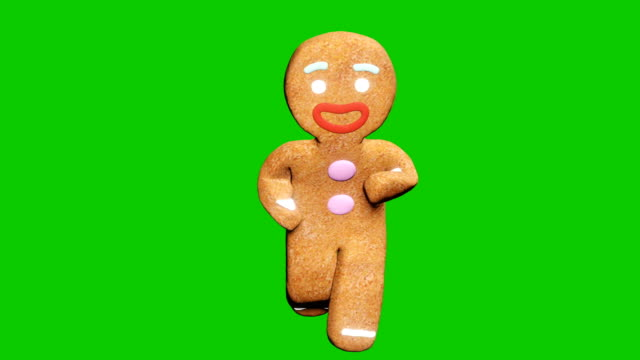 The gingerbread man is dancing a Christmas dance. The concept of the celebration. Looped animation in front of green screen. The gingerbread man is dancing a Christmas dance. The concept of the celebration. Looped animation in front of green screen. Produced in 4K. gingerbread man stock videos & royalty-free footage