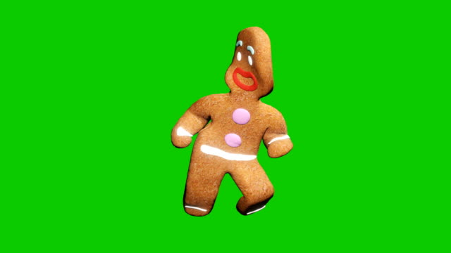 vídeos de stock e filmes b-roll de the gingerbread man is dancing a christmas dance. the concept of the celebration. looped animation in front of green screen. - christmas cookies