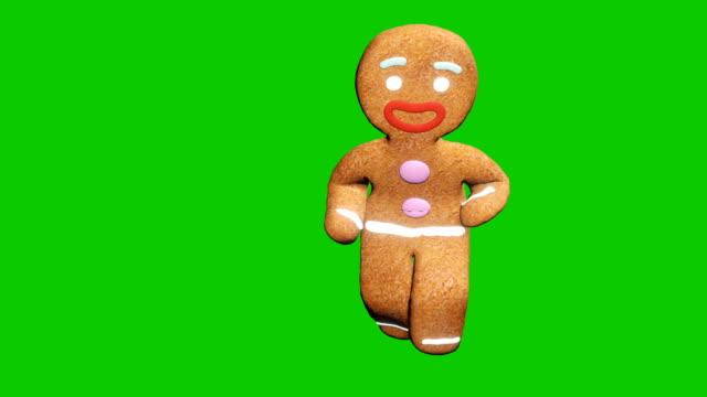 pepparkaksmannen dansar en juldans. begreppet fest. loopad animering framför grön skärm. - pepparkaka bildbanksvideor och videomaterial från bakom kulisserna