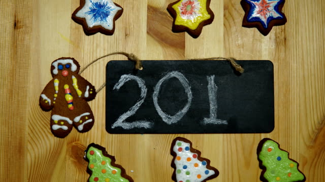 The gingerbreads board and with the numbers 2018, the New Year's background. video