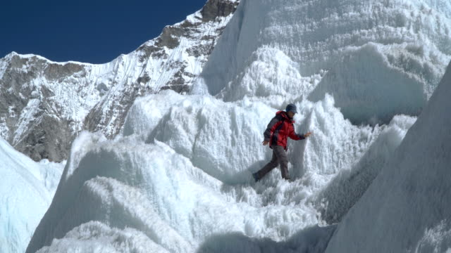 The girl climbs the glacier video