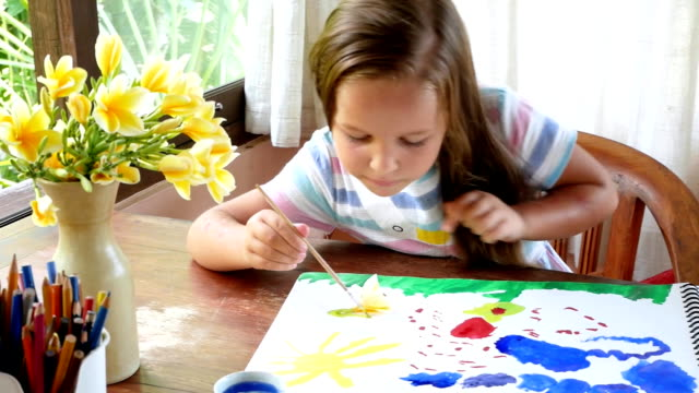 the girl draws a palette of watercolor paints. The process of creating a watercolor painting. video