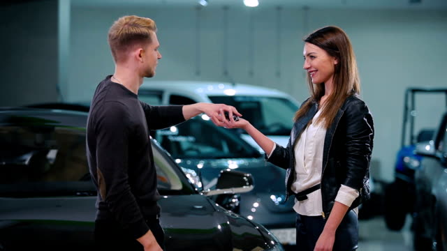 The girl get the keys from the electric car video