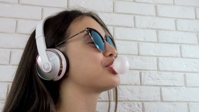 The girl in the headphones is chewing gum video