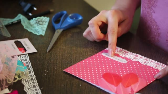 The girl is engaged in making greeting cards at home using paper the girl is engaged in making greeting cards at home using paper lace braid and other materials stock video more clips of art 915581444 istock m4hsunfo