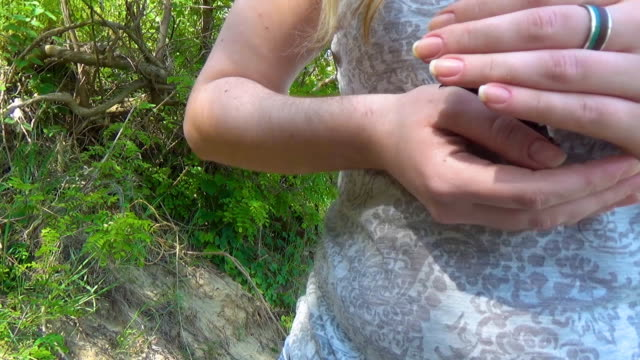 The girl is holding a small bat in her arms video