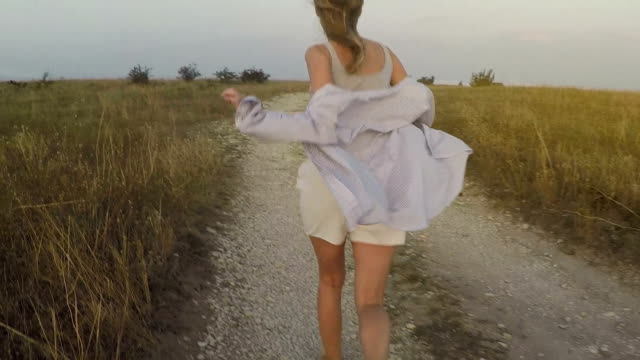 the girl is running in the wind flapping her shirt video