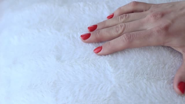the girl is stroking the white pillow. hand close-up. - lanuginoso video stock e b–roll