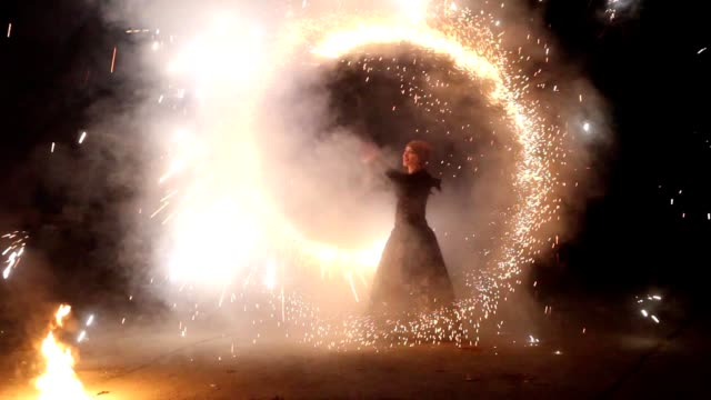 The girl on the ground shows the fire show. video