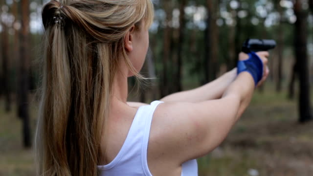 The girl shoots from an air gun video