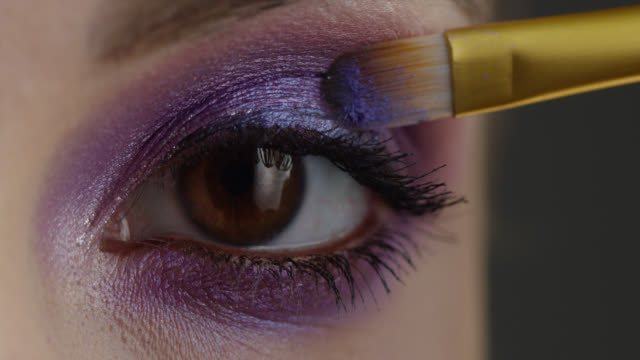 The girl uses mascara. Fashion video. Slow motion. The girl uses mascara. Fashion video. Slow motion. 4K 30fps ProRes 4444 stock video eyeshadow stock videos & royalty-free footage
