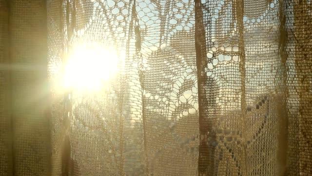 The glare of the sun through a curtain window room. Glare lenses