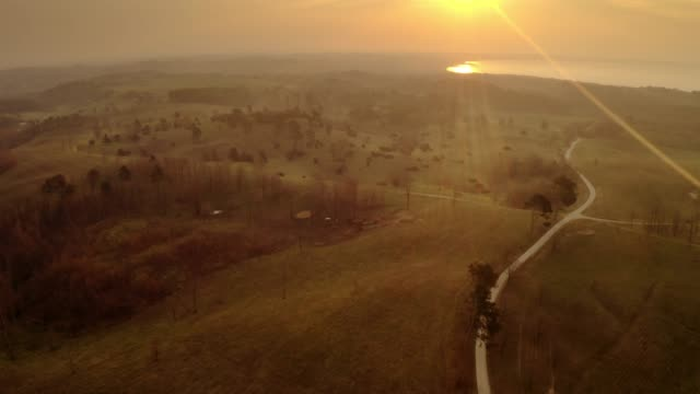 The golden sun over the land Stunning aerial shot of the sun over Jutland's rural area. denmark stock videos & royalty-free footage