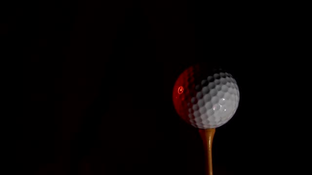 The golfer's concept aims for victory, golf balls and combustible golf clubs