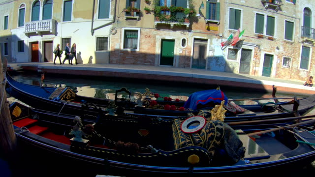 The gondolas on the side of the canal in Venice Italy video