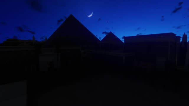 The Great Pyramids at Giza against starry sky, Cairo, Egypt 4K