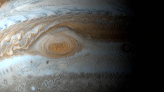 the great red spot in planet jupiter rotating - jowisz filmów i materiałów b-roll