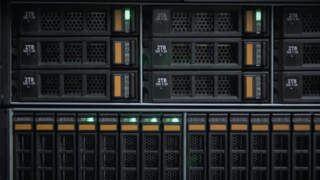 the green lights flash on the data store in the server room