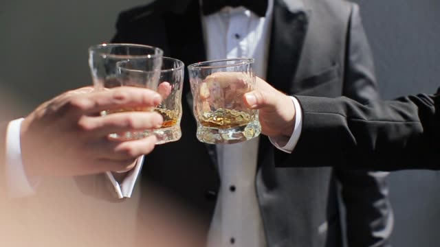 the groom and his friends drink whiskey - scotch whisky video stock e b–roll