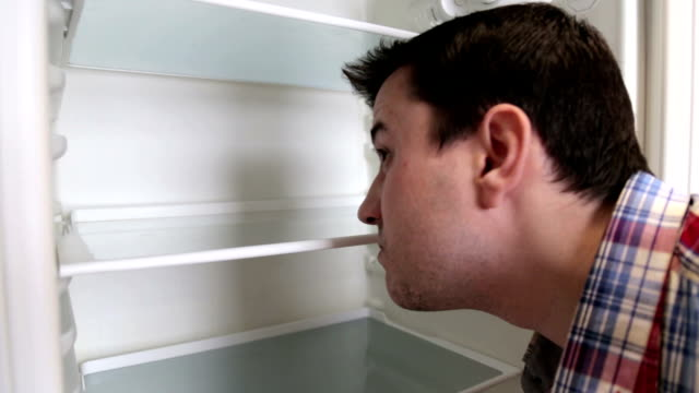 The guy is trying to find food in the fridge Empty fridge at home fridge stock videos & royalty-free footage