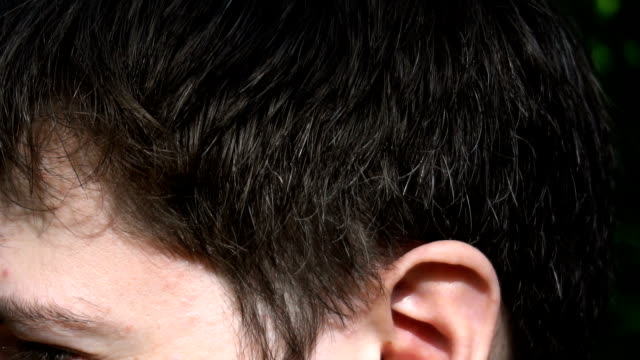 the hair of a young man, close up - inghilterra sud orientale video stock e b–roll