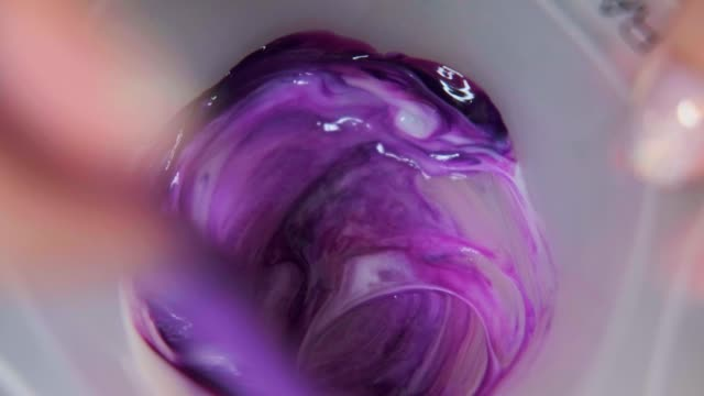The hairdresser colorist mixes paint for hair dyeing. The hairdresser colorist mixes paint for hair dyeing. Close-up. highlights hair stock videos & royalty-free footage