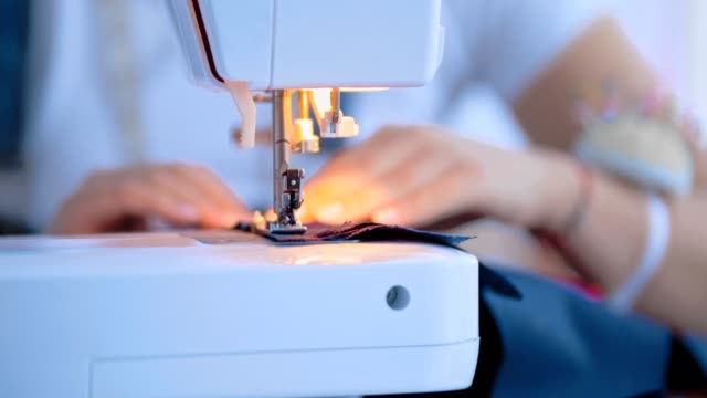 the hands working with a sewing machine - sarta video stock e b–roll