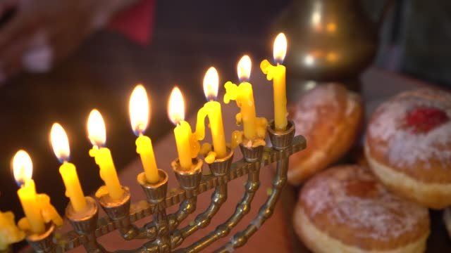 The Hanukkah menorah is a nine-branched candelabrum lit during the eight-day holiday of Hanukkah The Hanukkah menorah is a nine-branched candelabrum lit during the eight-day holiday of Hanukkah. Sufganiyah is a round deep-fried jelly doughnut eaten in Israel hanukkah stock videos & royalty-free footage