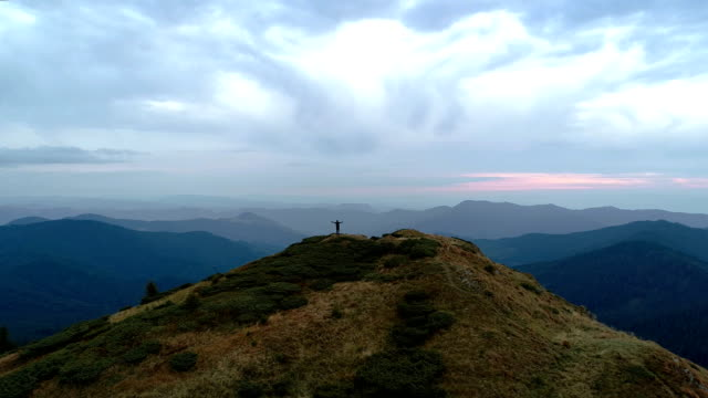 The happy man on the top of the mountain enjoying the scenic landscape The happy man on the top of the mountain enjoying the scenic landscape mountains in mist stock videos & royalty-free footage