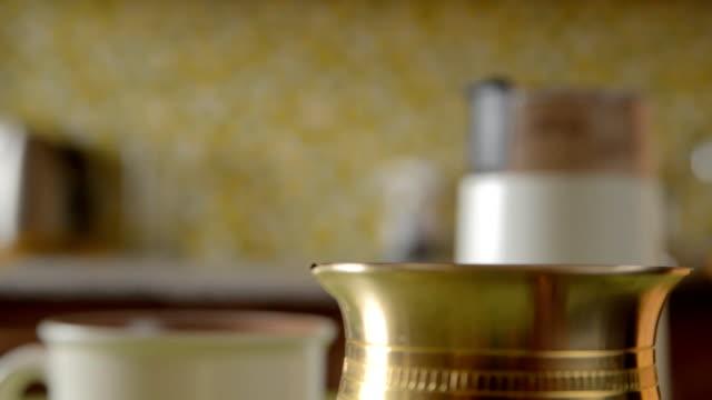 the home coffee in table. - argento metallo caffettiera video stock e b–roll