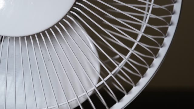 The household fan stops to rotate the blades. A moving fan to cool the you on a hot summer day. The household fan stops to rotate the blades. A moving fan to cool the you on a hot summer day. household fixture stock videos & royalty-free footage