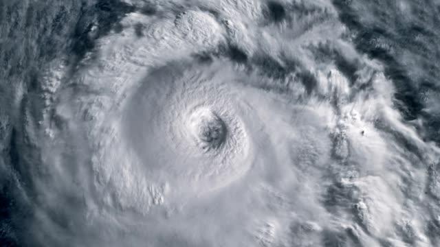 the hurricane storm with lightning over the ocean., satellite view. - вид со спутника стоковые видео и кадры b-roll