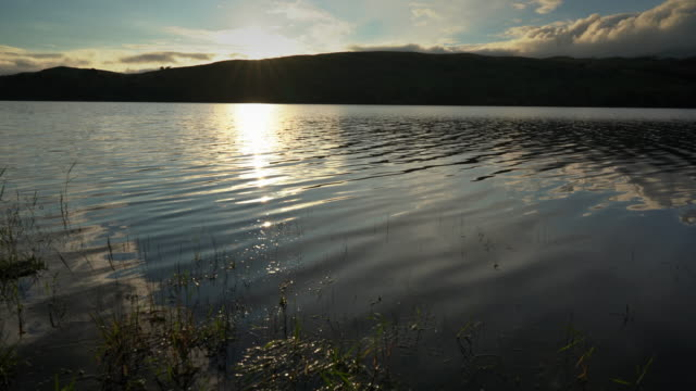 the incredibly relaxing coniston water in the english lake district a truly magical place - horyzont wodny filmów i materiałów b-roll