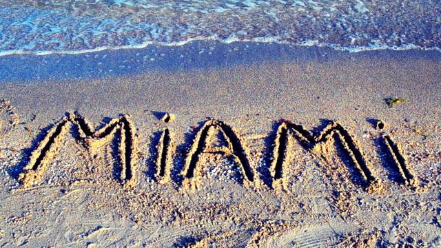 The inscription Miami on sand. video