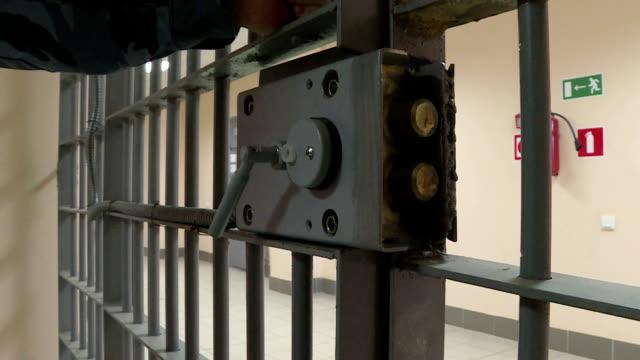 the iron door in prison. - prigione video stock e b–roll