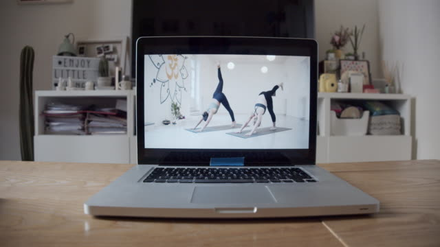 The laptop is ready for an online yoga video lesson video