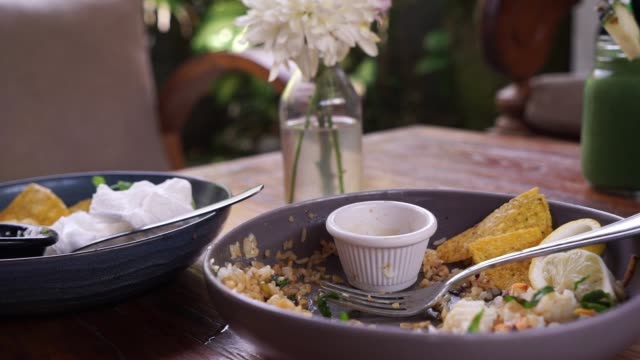 The leftover food and dirty dishes on the restaurant table. The leftover food and dirty dishes on the restaurant table. leftovers stock videos & royalty-free footage