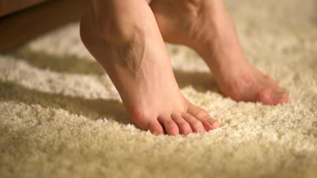 the legs on the beige carpet - moquette video stock e b–roll