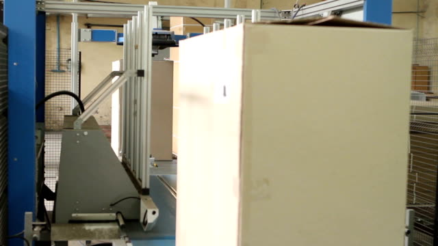 The line for packing finished furniture at the woodworking and furniture plant video