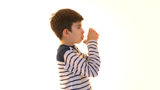 The little boy is drinking water with pill video