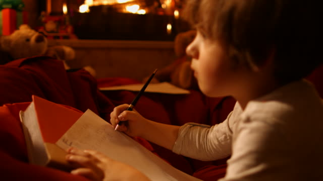 The little boy writes a letter to Santa The little boy writes a letter to Santa - 4k ProRes (HQ). note message stock videos & royalty-free footage