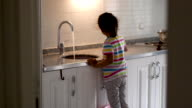 istock the little girl drinks from mains water 1277433460