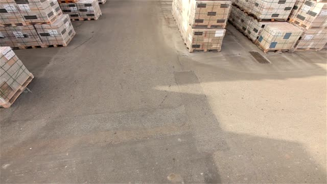 The loader transports cargo in a warehouse, a loader in a warehouse, a warehouse of a large enterprise, industrial interior video