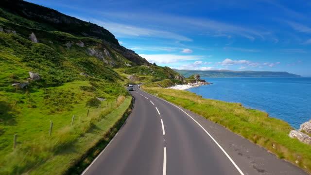 The long road and the coastal shore in Cushendun in Ireland video