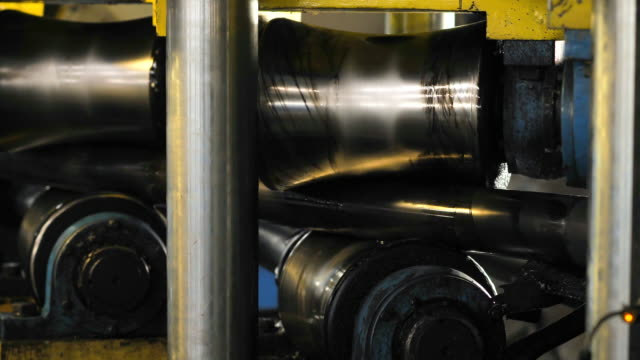 The machine aligns the metal pipe Tube Rolling Machine At The Factory. The machine aligns the metal pipe stainless steel stock videos & royalty-free footage