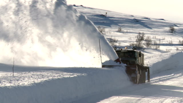 the machine cleans the snow on the track the machine cleans the snow on the track plow stock videos & royalty-free footage