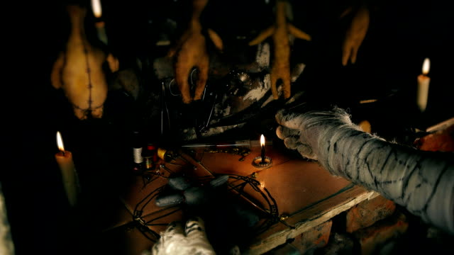 the mage conducts a ritual with the voodoo doll video