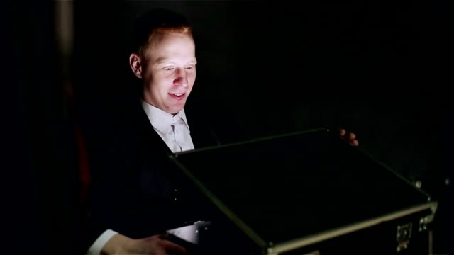 The magician opening the magic box in a dark room. video