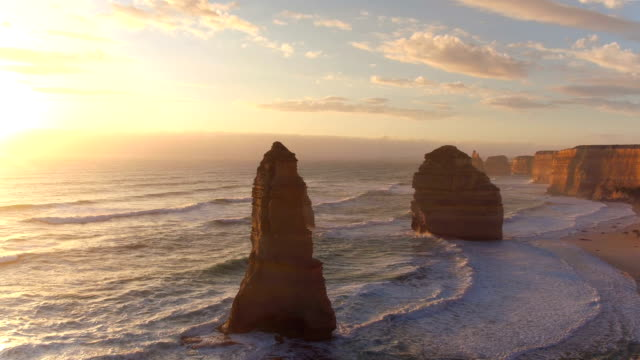 aerial: the majestic twelve apostles along the rocky australian ocean shore - cliffs stock videos & royalty-free footage