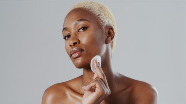 The makeup remover that's gentle on my skin 4k video footage of a beautiful young woman wiping her face with a cotton disc against a grey studio background make up stock videos & royalty-free footage